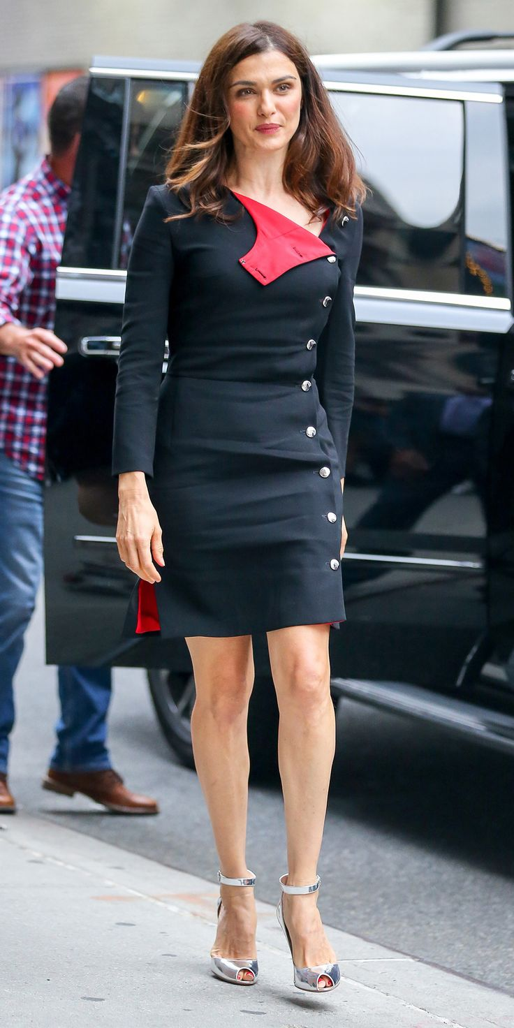 Rachel Weisz was subtle in her playfulness when she selected a structured LBD that would have been plain if it hadn't been for its eye-popping red lining and the silver buttons running along the side—an accent that she carried over to her metallic sandals.