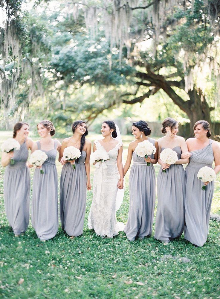Bridesmaids in gray gowns Photography: Marissa Lambert…