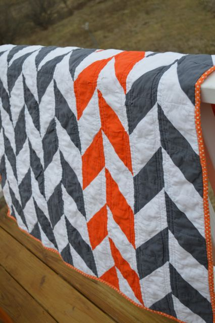 I love the pop of orange with the grey and white, and the polka dot binding.