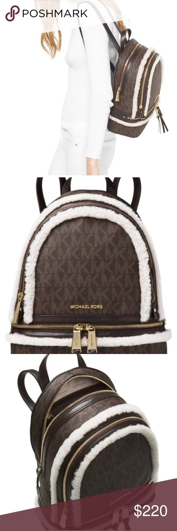 Brown MK Logo Shearing Rhea signature backpack Brown/ neutral MK logo backpack. Framed with soft shearing and gold zipper detail. Signature lingo stands out on this backpack. Top zip closure, lined, two exterior zip pockets, gold tone hardware. Interior features: 1 zip pocket, 3 open pockets, key clip. Perfect for traveling because of the deep pockets. KORS Michael Kors Bags Backpacks
