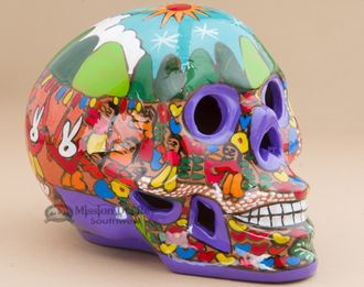 This is a beautiful southwestern day of the dead skull. Handcrafted in Mexico, this skull is hand painted ceramic, one of the favorites among day of the dead memorabilia. So popular in the southwester