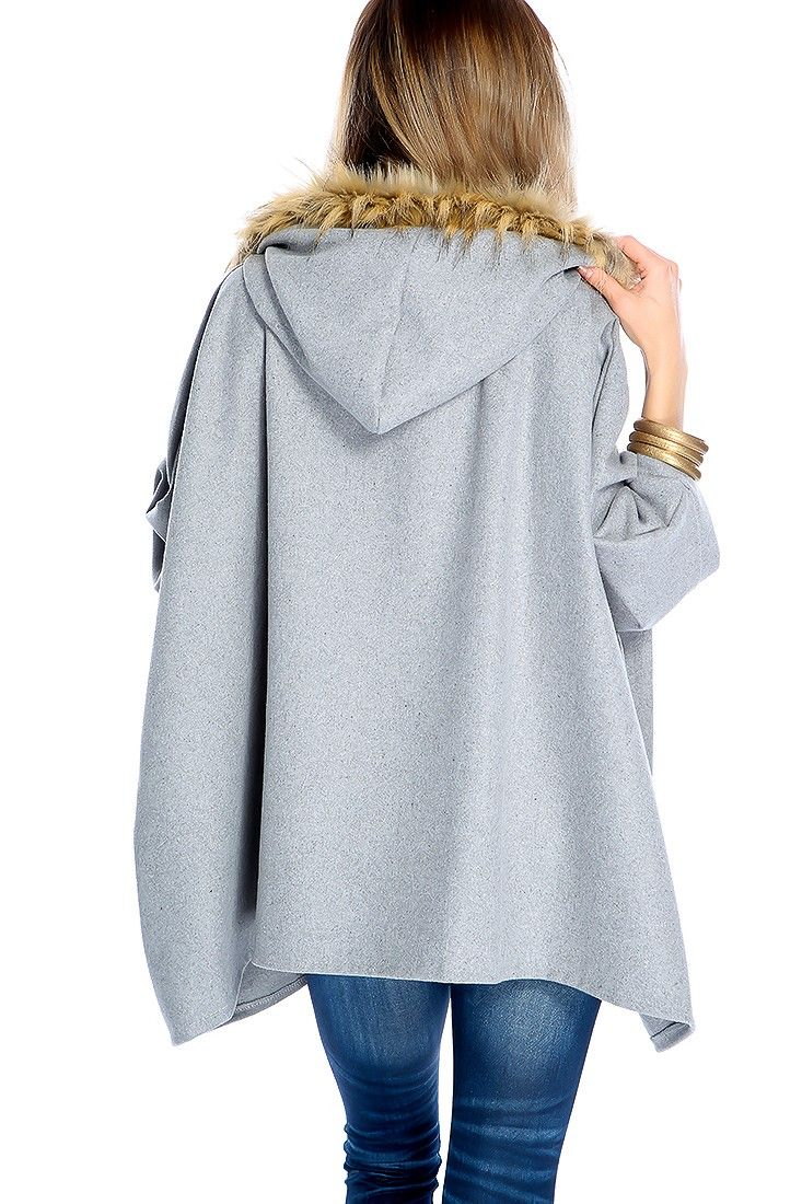 Keep warm and stylish in this cute poncho. Featuring faux fur hoodie, and quarter sleeves. 100% Polyester