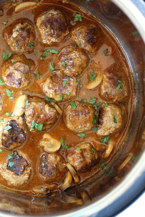 These beefy meatballs are cooked in a mushroom gravy and lightened up by using half ground turkey and half lean ground beef.