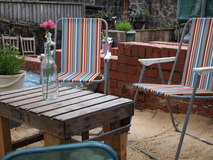 Stripy deck chairs in our Beach garden at Designate @ the gate
