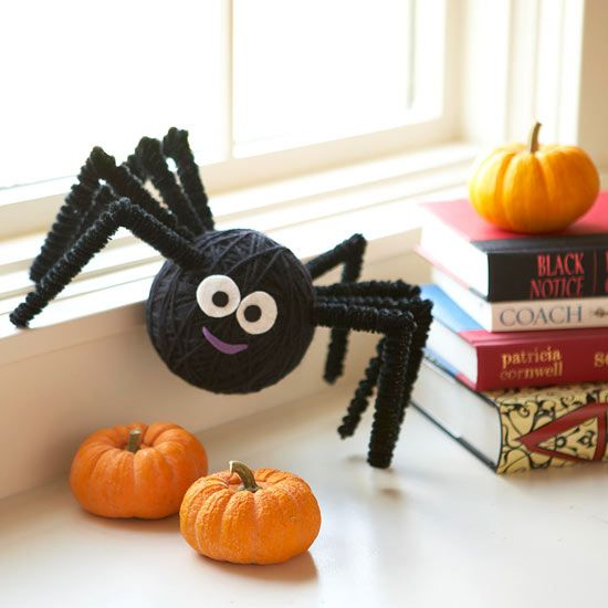 Friendly Halloween Spider-This itsy bitsy spider is made from a plastic foam ball wrapped with black yarn, chenille stems, and felt scraps -- it's easy to make in multiples to set on windowsills, countertops, and fireplace mantels.