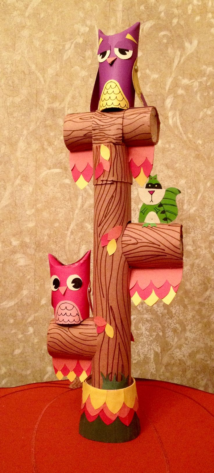 Owl and raccoon tree perch made out of toilet paper tubes, card stock and construction paper.