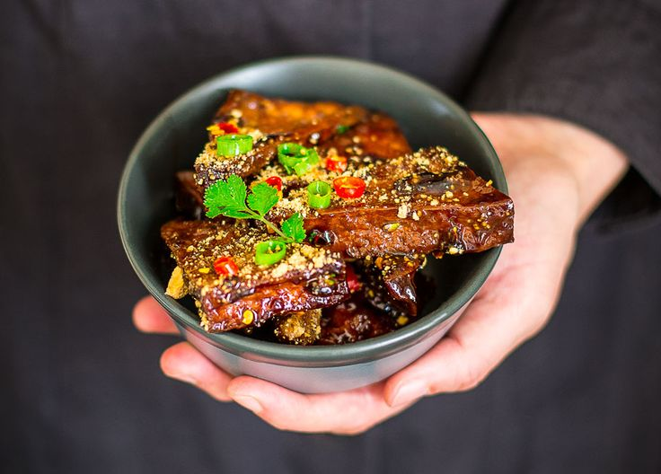 These delicious braised tofu is infused with flavor from sesame oil, oyster source, wine and honey, served with fresh herbs and roasted peanut powder.