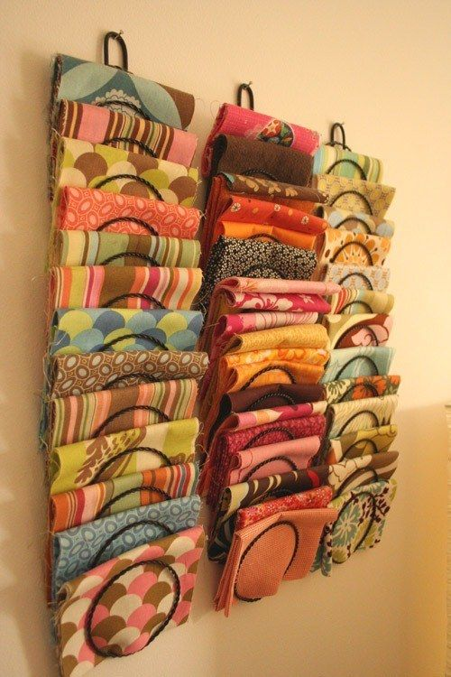 Fabric yardage is easy to get at when you keep it in a magazine rack. | Community Post: 45 Organization Hacks To Transform Your Craft Room