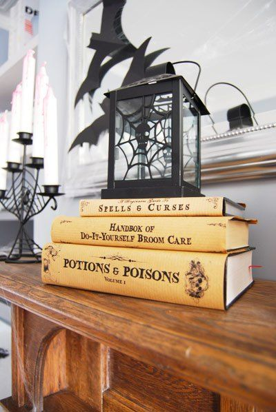 Decorate the house for Halloween. Free printable book covers for witches and wizards.