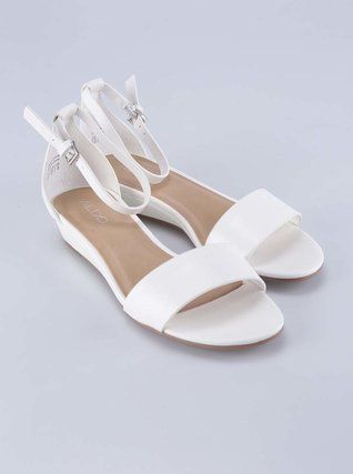 White ankle strap sandals from Aldo.