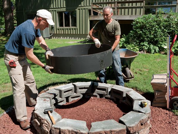 Next, we bolted together the two steel pieces that form the fire ring, placed it in the pit, and tapped it with a rubber mallet to get it to settle into the crushed stone.   - PopularMechanics.com