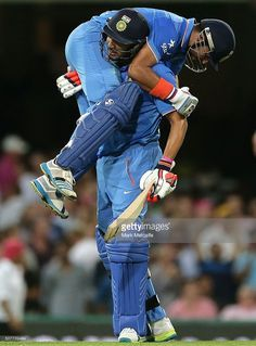 Suresh Raina of India and Yuvraj Singh of India celebrate victory in the International Twenty20 match between Australia and India at Sydney Cricket Ground on January 31, 2016 in Sydney, Australia.
