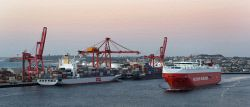 TWA-0002426 © WestPix A cargo ship leaving Fremantle Harbour just before sunset…