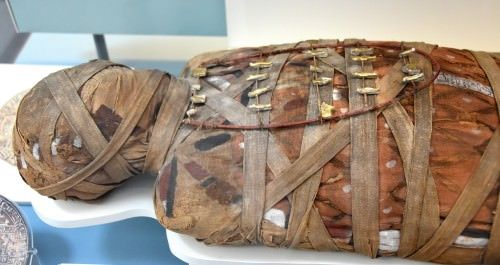 The practice of mummifying the dead began in ancient Egypt c. 3500 BCE. The English word mummy comes from the Latin mumia which is derived from the Persian mum meaning 'wax' and refers to an embalmed...