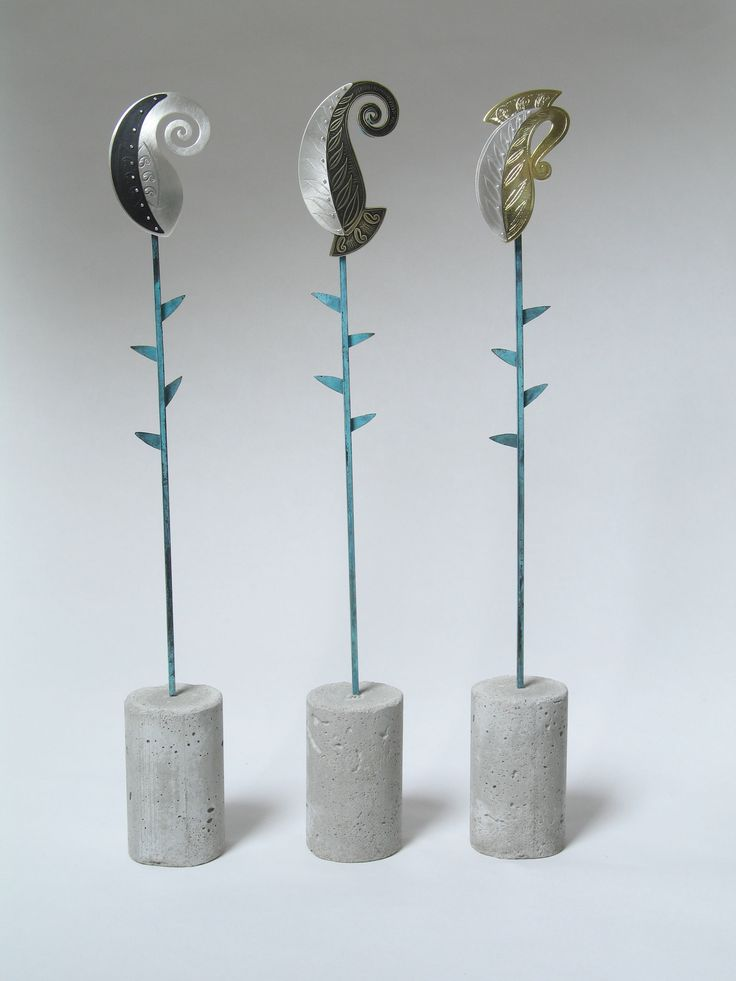 """""""Rebirth""""; pins on concrete and brass stands. Pins: etched sterling silver and brass, patina."""