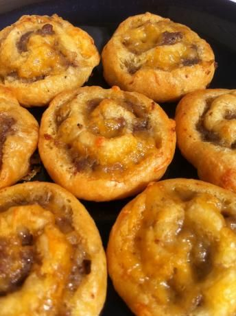 Sausage pinwheels. 2 ingredients how easy!  You can add cheese or exchange sausage with chopped ham, bacon bits or pepperoni...just as good!  Be sure and use the Pillsbury Crescent Roll dough, for some reason, it works best!
