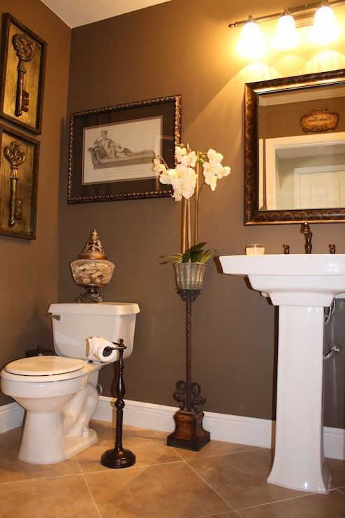 1/2 bath redo...... Love this paint color (Behr Mocha Latte) Makes it so cozy!.Framed keys