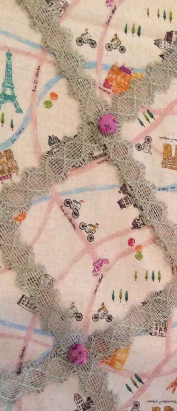 Memory board detail. Bright pink covered buttons add a pop of colour on top of the neutral colour lace.