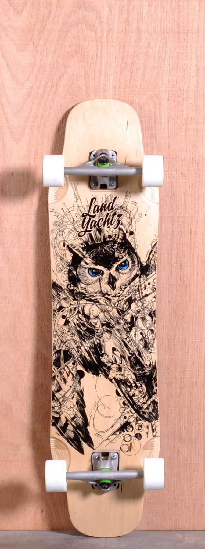 """The Landyachtz Tomahawk Longboard Complete is designed for Freeride, Sliding, Downhill and Cruising. Ships fully assembled and ready to skate! Function: Freeride, Sliding, Downhill, Cruising Features: Medium W Concave, Micro Drop, Kicktail, Upturned Nose, Recessed Flush Truck Mount, Flared Wheel Wells, Multiple Wheelbase Options Material: 7 Ply Maple, Length: 38"""" Width: 10"""" Wheelbase: 22.7' - 25.5"""" Thickness: 9/16"""" Hole Pattern: Old School Grip: Black"""