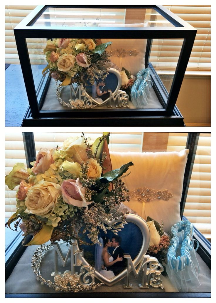 Created this courtesy of ideas found on Pinterest!   Silica gel & flower preservation spray for my wedding bouquet, then included his boutineer, my tiara, garter belt, our picture, and ring bearer pillow all in a football display case.
