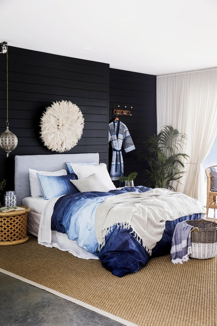 The coastal style calls for natural materials such as timber and wicker. Here, a 'Marmara' towel in Midnight Blue spills out of a 'Wicker' hamper, while a wooden 'Basic' wall hook displays a cotton 'Tieppo' kimono robe.