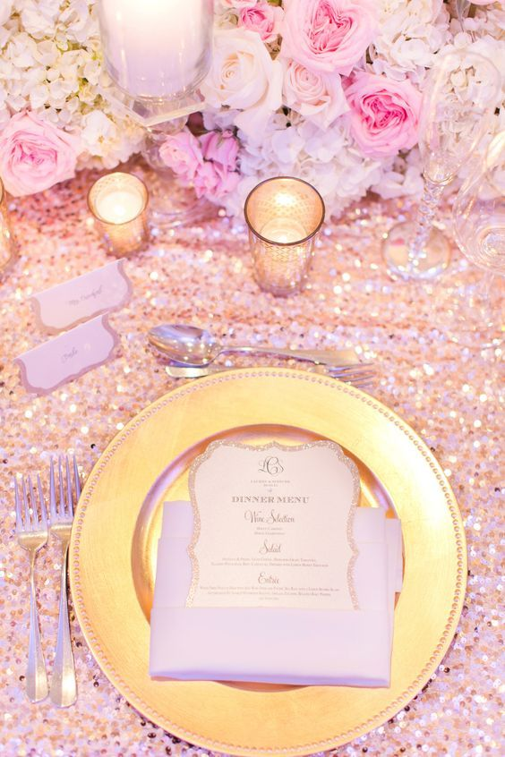 Fairytale wedding tablescape. Dinner menu set on top of charger plates for romantic glitz.