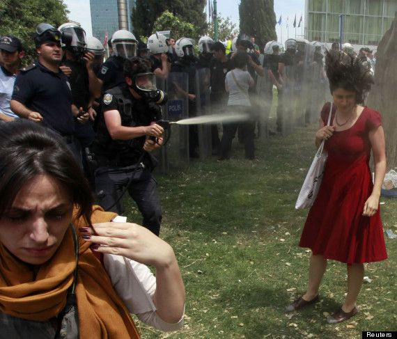 """""""The woman in red"""" pepper sprayed - Ceyda Sungur, an academic at Istanbul's university stood defiantly in Taksim Square, centre of the uprising in Turkey this year (2013). She is one of the so-called """"extremists"""" who government are blaming for the demonstrations. This incident many cite as the spur for activists to take to the streets en masse in support of what had been up till then a small demonstration."""