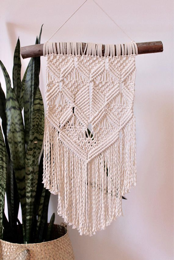 This beautiful macrame wall hanging is hand