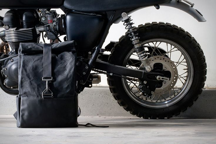 Hammarhead Industries Day Pack ($290). Crafted from waterproof waxed cotton, black leather, and parachute hardware, the Pack features a rolltop closure, interior compartments for a laptop, iPad, and Kindle, and an industrial style that'll look great perched atop your two-wheeled monster.    Uncrate - knows how to speak to me.