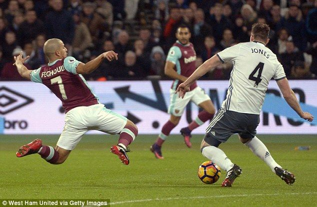 Jan. 2nd. 2017: Sofiane Feghouli (left) launched into a tackle with Manchester United's Phil Jones after the ball was over-hit, and he was sent off by referee Mike Dean in a game won 2-0 by the Red Devils