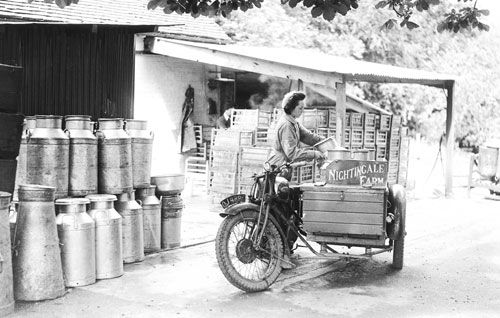 Women's Land Army delivering milk by motorbike, Tunbridge Wells, Kent (1943).  Five land girls do the retail round with BSA combines.