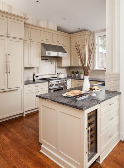 These cabinets have such a warm, creamy tone in this transitional Kitchen by Samantha Friedman Interior Designs