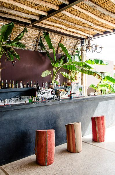 Ceiling design, black bar, and stools- very tropical