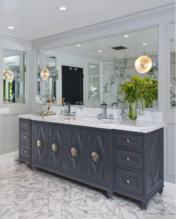 Gray and Marble coloring helps lift the bathroom atmosphere to opening and inviting...