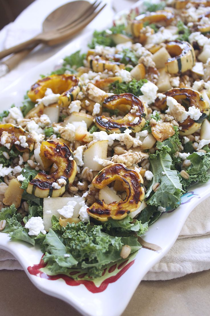 1 Delicata Squash     1 tablespoon of olive oil     1/2 teaspoon of salt     3 cups of kale     1 cup of farro, cooked     1 pear, cut into cubes     4-5 cloves of garlic, roasted and chopped (can be roasted while you're roasting the squash)     1/4 cup goat cheese crumbles     For the dressing     3 tablespoons of maple syrup     3 tablespoons of olive oil     2 tablespoons of balsamic vinegar     1/4 teaspoon of salt     1 teaspoon of dijon mustard     1 clove of garlic, roasted