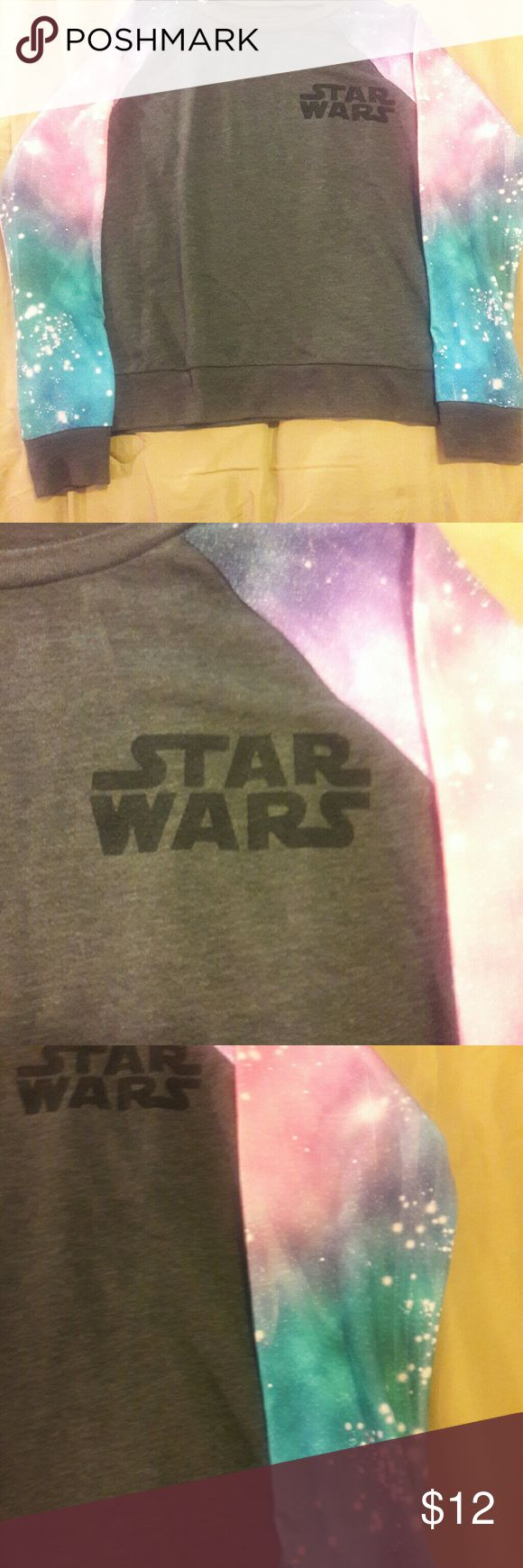 Star wars sweatshirt Size small gray with galaxy sleeves. Darth Vader on the back in black. 60% cotton and 40% polyester. Star Wars Tops Sweatshirts & Hoodies