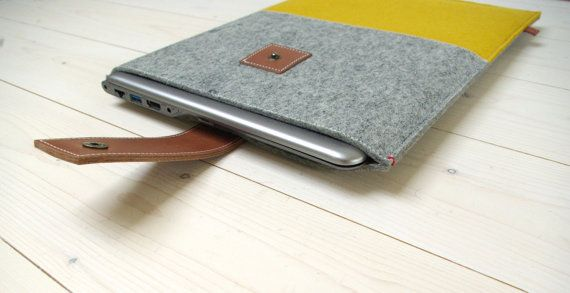 Pick any colour from our shop for this 13 inch laptop case with leather closure.