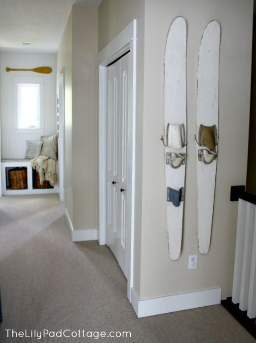 House Tour - The Lilypad Cottage I never thought of using skis as a decorative element in hour home. Now I know what to do with my old slalom.