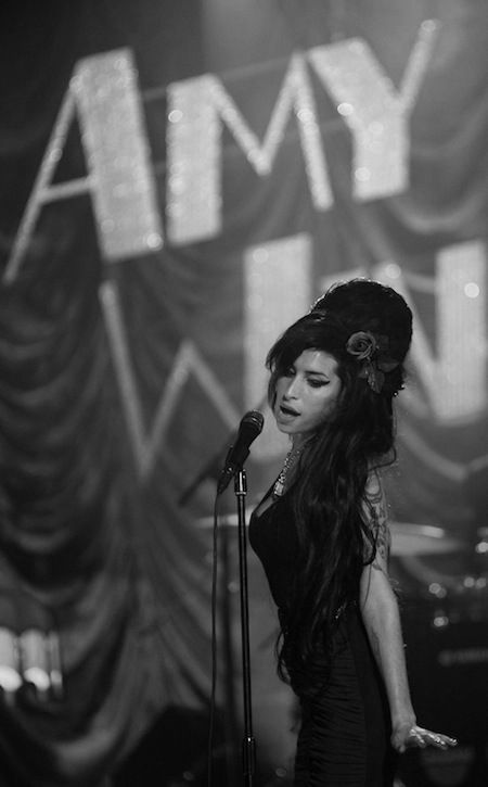 Amy Winehouse / Miss that voice and sad there won't be more soulful sounds escaping those gifted vocal chords of gold...  : (