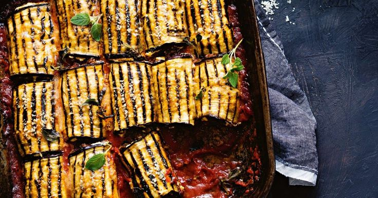 This twist on the classic moussaka combines smoky eggplant with a cheat's white sauce and aromatic lamb, baked with tomato sauce and cheese. Make this recipe up to 2 days ahead.