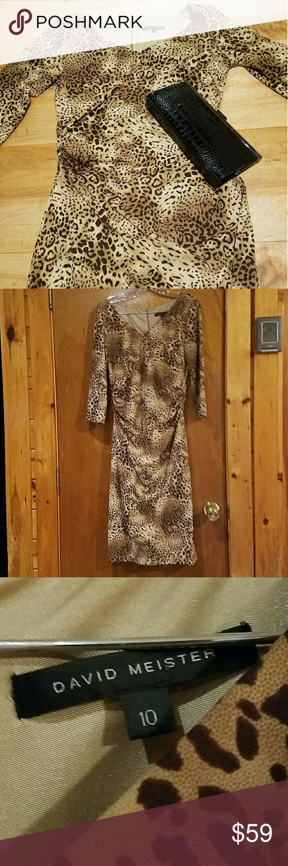 David Meister Cheetah Print Dress This dress is so flattering- the fabric is heavy and drapes well, and the ruching at the waist hides a lot of sins. Perfect for date night. Beautiful condition, smoke free home. David Meister Dresses