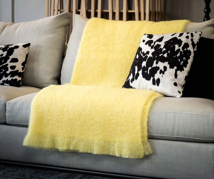 This lemon yellow mohair throw work brilliantly with black and white as shown on this sofa. Also great in a babies bedroom.