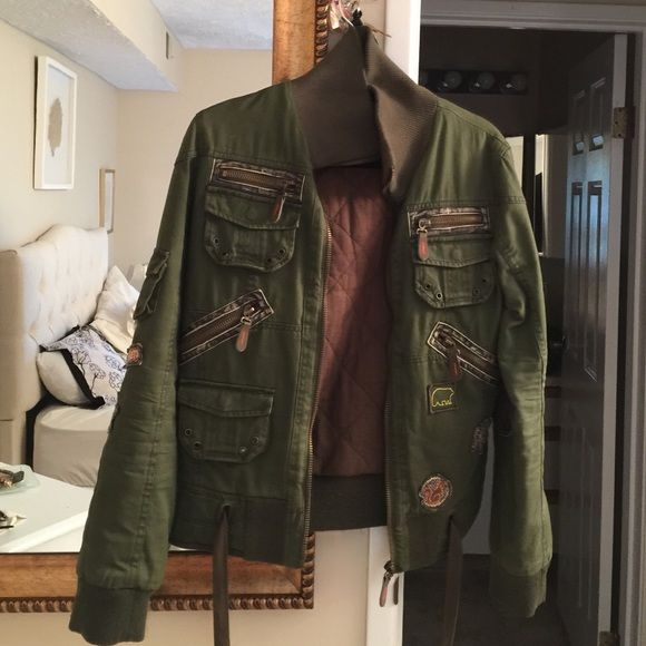 Military bomber jacket Green military bomber jacket with slight wear on the elbow but makes it look vintagey. Bought it in London when I was on vacation Only The Unlimited Label Jackets & Coats