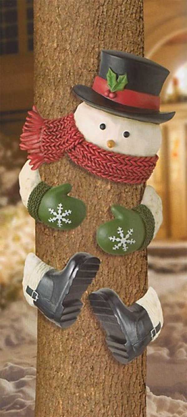 3. Everyone will love this cutest snowman tree hugger. - 10 Cool Ideas to Decorate Garden or Yard Trees for Christmas