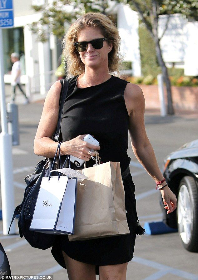 Model behaviour: The 46-year-old went make-up free as she treated herself to a shopping spree at Fred Segal, wearing a classic black mini dress for the occasion