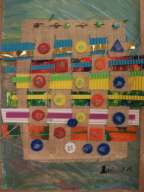 3rd grade weaving  Cool, solid weft--I was going to say warp but I wemembered that the weft goes weft to wight...:)  I'd do that with youngers (K-1)