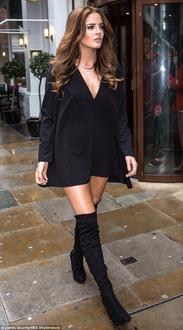 Work it! The 25-year-old had all eyes on her as she rockedthigh high boots with very low-cut mini swing dress