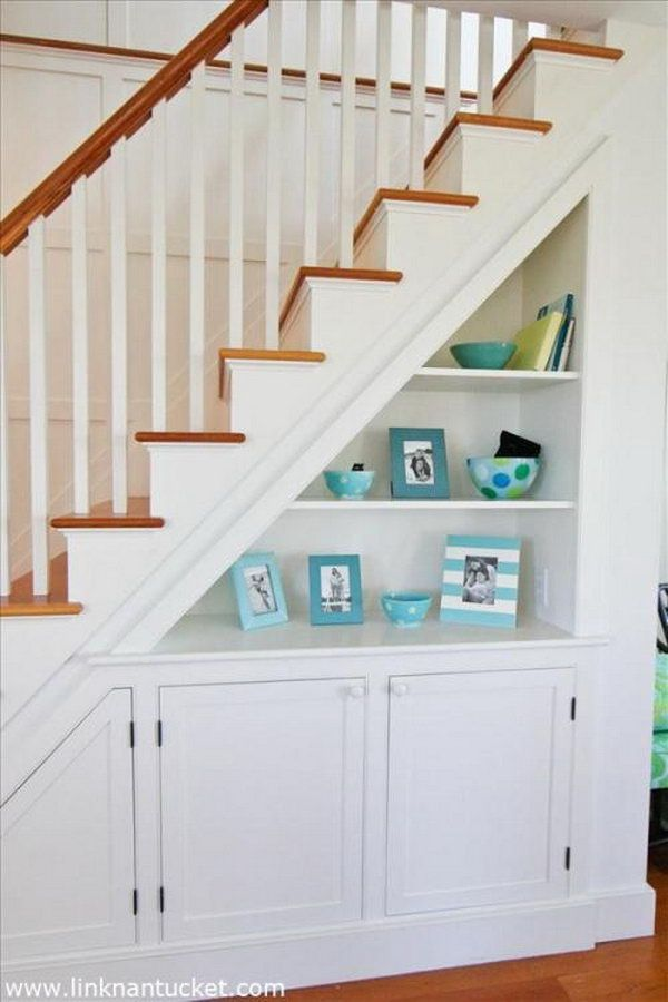 Clever way to mix the shelving and cabinets for more extra storage under the stairs.                                                                                                                                                                                 More