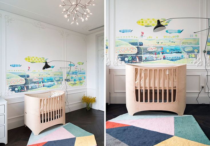 In this nursery they combine old with new. Colorful artwork has been added to the walls and a geometric rug adds a soft surface for the child to play on, white more traditional elements have been added to the walls.