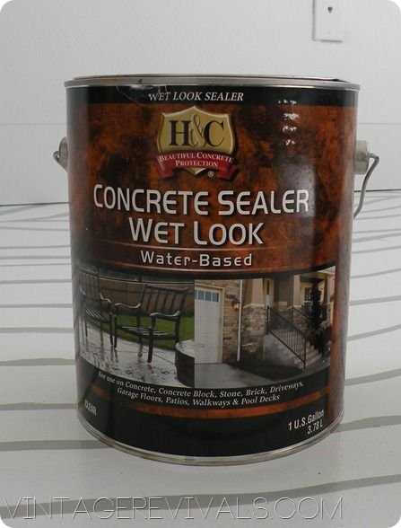 Apply the topcoat the same way that you painted the floor.  I did 2 coats of H Wet Look Concrete Sealer.